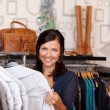 Stock Photo: Customer Choosing Shirt In Clothing Store