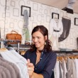 Customer Looking At Shirt In Clothing Store — Stock Photo