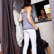 Woman Looking At Mirror While Standing In Changing Room — Stock Photo #26669635