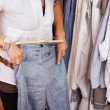 Woman Trying Blue Trouser In Clothing Store — Stock Photo