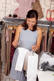 Customer Looking In Shopping Bag At Boutique — Stock Photo