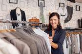 Smiling Woman Choosing Shirt In Clothing Store — Stock Photo
