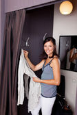 Woman Looking In Camera While Standing In Changing Room — Stock Photo