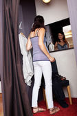 Woman Looking At Mirror While Standing In Changing Room — Stock Photo