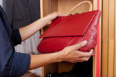 Holding Red Handbag In Store — Stock Photo