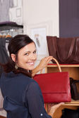 Woman Holding Purse In Store — Stock Photo