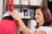 Saleswoman Examining Clothes On Mannequin — Stock Photo