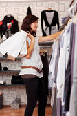 Female Customer Choosing Clothes From Rack — Stock Photo