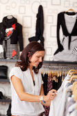 Female Customer Looking At Clothes — Stock Photo