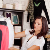 Mid adult saleswoman Examining Clothes On Mannequin — Stock Photo
