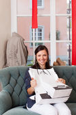 Happy Woman With Shopping Bags Sitting On Sofa At Clothing Store — Stock Photo