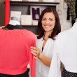 Woman Examining Clothes On Mannequin In Clothing Store — Stok fotoğraf