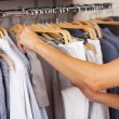 Choosing Shirt From Rack In Clothing Store — Stock Photo