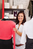 Woman Examining Clothes On Mannequin In Clothing Store — Stock Photo
