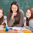 Cheerful teacher with students — Stock Photo