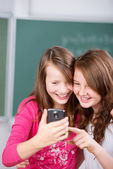 Students with cellular phone — Stock Photo