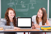 Students with laptop — Stock Photo