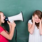 Young schoolgirl making herself loudly heard — Stock Photo