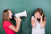 Young schoolgirl making herself loudly heard — Stock Photo