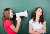 Girl trying to make herself heard with a megaphone — Stock Photo
