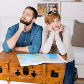 Couple With Map Leaning On Suitcase In House — Stock Photo