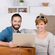 Happy Young Couple With Laptop — Stock Photo