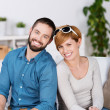 Young Couple Smiling Together In House — Stock Photo #26742777