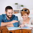 Young couple planning a travel — Stock Photo