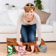 Woman Trying To Close Her Suitcase — Stockfoto