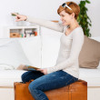 Woman With Map Pointing While Sitting On Suitcase — Stock Photo