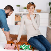 Couple Trying To Close Suitcase At Home — Foto de Stock