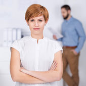 Businesswoman With Coworker In Background — Stock Photo