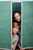 Students Hiding Behind Green Panels — Stock Photo