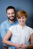 Couple Laughing Together Over A Blue Background — Stock Photo