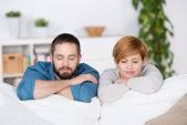 Couple With Eyes Closed On Sofa — Stock Photo