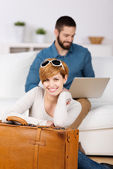Young Woman With Briefcase And Man Using Laptop — Stock Photo