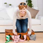 Woman Trying To Close Her Suitcase — Stock Photo
