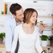 Young man feeds his girlfriend — Stock Photo