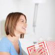 Excited woman holding a large gift box — Stock Photo
