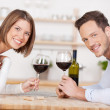 Smiling couple drink red wine — Stock Photo