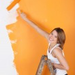 Smiling girl painting — Stock Photo #26808329