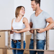 Teamwork - young couple moving house — Stock Photo