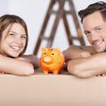 Couple and piggybank — Stock Photo