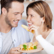 Couple enjoys a bite of cheese — Stock Photo