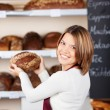 Stock Photo: Friendly worker in a bakery