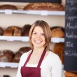 Friendly worker in a bakery — Stock Photo