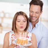 Blowing candle cake — Stock Photo