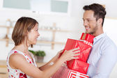 Couple with gift — Stock Photo