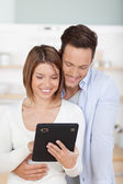 Couple with tablet — Stock Photo