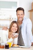 Happy couple having breakfast — Stock Photo